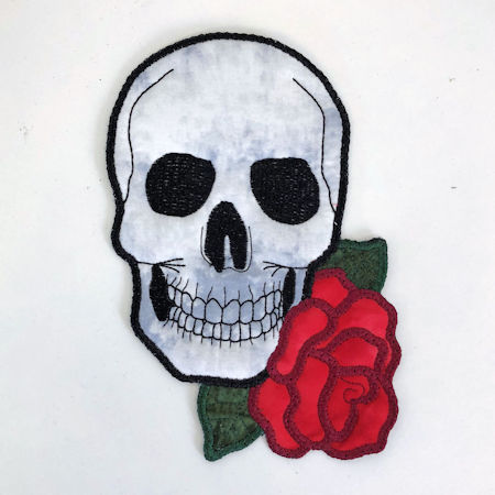 In the hoop Skull with Roses Coaster