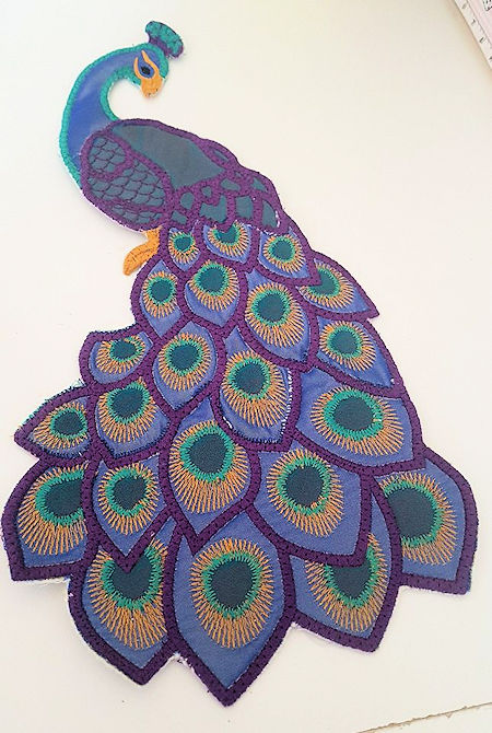 Peacock in the hoop by Lorraine