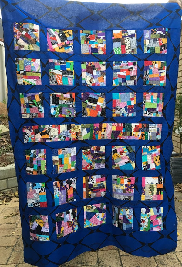 Quilt made using Crazy Patch Fabric by Faye